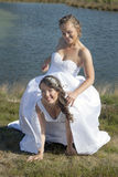 Just married happy lesbian couple in white dress has fun near sm Royalty Free Stock Photo