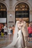 Just married interracial couple dancing in the Galleria Vittorio Emanuele in Milan stock image