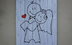 Just married. Cartoon on the wall Royalty Free Stock Photos
