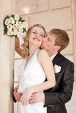 Just married kissing outdoors Royalty Free Stock Image