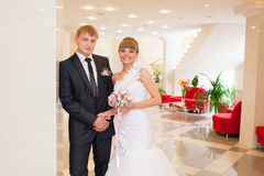 Just married. Kissing in the registrar`s office building royalty free stock photos