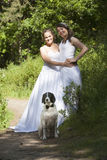 Just married lesbian pair with dog in forest Royalty Free Stock Images