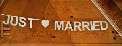 Just married lettering, writing , wooden wall as background royalty free stock images