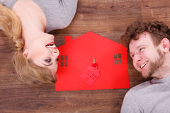 Just married lying on floor. Stock Photos