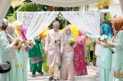 Malay Wedding. A malaysian couple newly wedding holding hands. stock photos