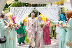 Malay Wedding. A malaysian couple newly wedding holding hands. Stock Photos