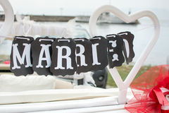 Just married note hanging from the car seat Stock Images