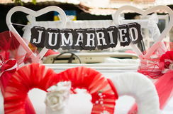 Just married note hanging from the car seat Stock Photography