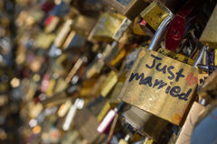 Just Married. A padlock with the text `Just Married` stands out from a blurred background. Taken on Pont Neuf Paris Royalty Free Stock Images