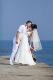 Just married on pier in day of them wedding Stock Image