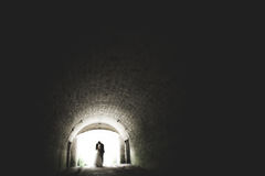 Just married poses and kissing with an old fortress on the background Stock Photos