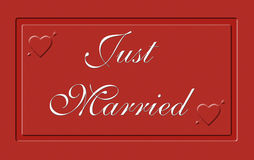 Just married on a red plate royalty free stock photo