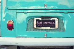 Just married sign on aquamarine classic vintage van. Concept of love - wedding and honeymoon in summer Stock Image