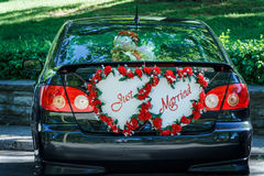 Just Married. A Just Married sign at the back of a car waiting for the newlywed couple Stock Photos