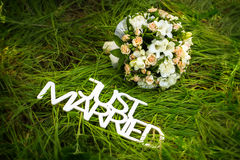 Just married sign with bouquet of roses Stock Photo
