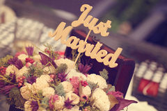 Just married sign in a flower bouquet Stock Photos