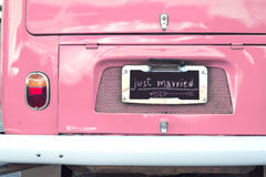 Just married sign on pink classic vintage van. Concept of love - wedding and honeymoon in summer Stock Images