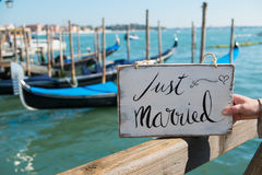 Just married sign. Romantic Just married sign with the gondolas in Venice Stock Photos