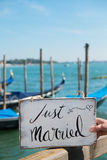 Just married sign. Romantic Just married sign with the gondolas in Venice Royalty Free Stock Photos