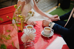 Just married sitting. On red table at coffeehouse Royalty Free Stock Photo
