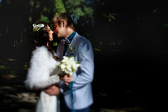 Just married smile while kissing. A Stock Photos
