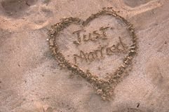 Just married surround by heart in the sand Royalty Free Stock Photo