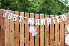 Just married text on the wall. Just married text garland on the wall Royalty Free Stock Images