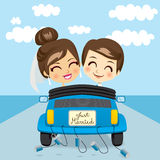Just Married Trip. Just married couple driving a blue car in honeymoon trip Royalty Free Stock Images