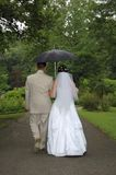 Just married twosome. With umbrella Royalty Free Stock Photo