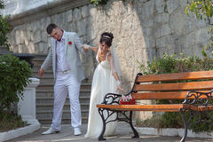 Just married walking in park Stock Photo