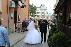Just married walking on the street in Lvov Stock Photography