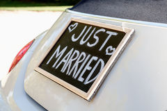 Just married. Wedding car with just married sign in a blackboard Royalty Free Stock Photo