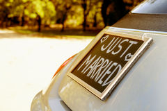 Just married. Wedding car with just married sign in a blackboard Royalty Free Stock Photography
