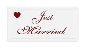 Just married sign on a white plate stock image