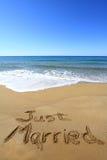 Just married. Written on golden sandy beach royalty free stock photos