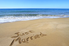 Just married. Written on golden sandy beach royalty free stock images