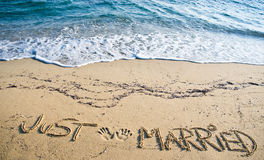 Just Married written in the Sand Stock Images