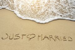 Just married written on sand beach near sea Royalty Free Stock Photos