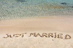 Just Married written in sand on a beautiful beach Stock Image