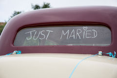 Just Married written on the trunk of a red car Stock Photo