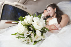 Just married young couple. Just married joyful young couple inside limo Royalty Free Stock Image