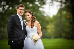 Just Married, Young Wedding Couple In A Park Stock Photo