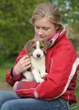 Just Mischief. Teenage girl cuddles her wonderful mischievious puppy Royalty Free Stock Photos
