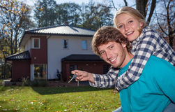 Just moved in. A happy couple after having moved into their new house Royalty Free Stock Photography