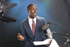 Just in the news. TV/Radio news anchor with prompter and microphone Stock Photos