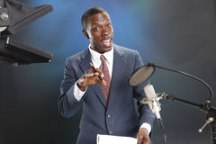 Just in the news. TV/Radio news anchor with prompter and microphone Royalty Free Stock Images