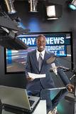 Just in the news. TV/Radio news anchor with prompter and microphone Stock Images