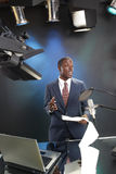 Just in the news. TV/Radio news anchor with prompter and microphone Stock Image