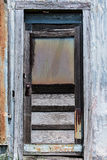 Just an old forgotten door. Door of an old settlement home long forgotten royalty free stock image