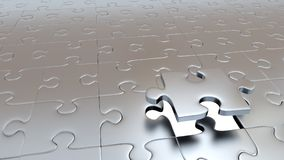 One Big Silver Puzzle Piece which stay above the others. Just One Big Silver Puzzle Piece which stay above the others Royalty Free Stock Image